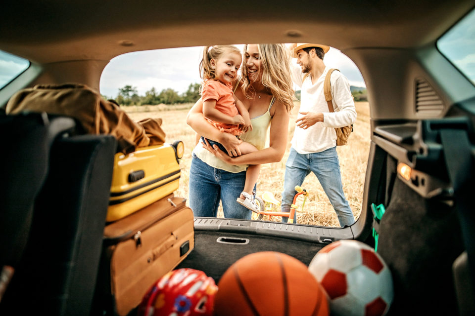Parents with kid going to picnic with car